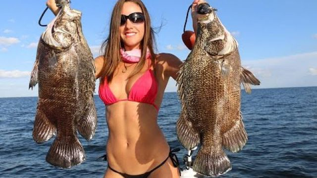 Fishing girl catches tripletail with 3 other hooks in its belly